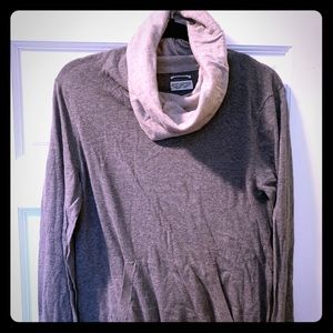 A turtleneck sweater with oversized cowl neck.